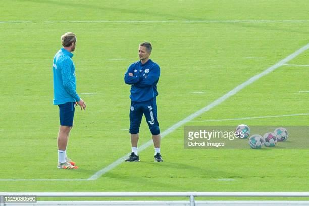 Goalkeeper Ralf Faehrmann of FC Schalke 04 and Athletic coach Werner Leuthard of FC Schalke 04 look on during the FC Schalke 04 training Session on...