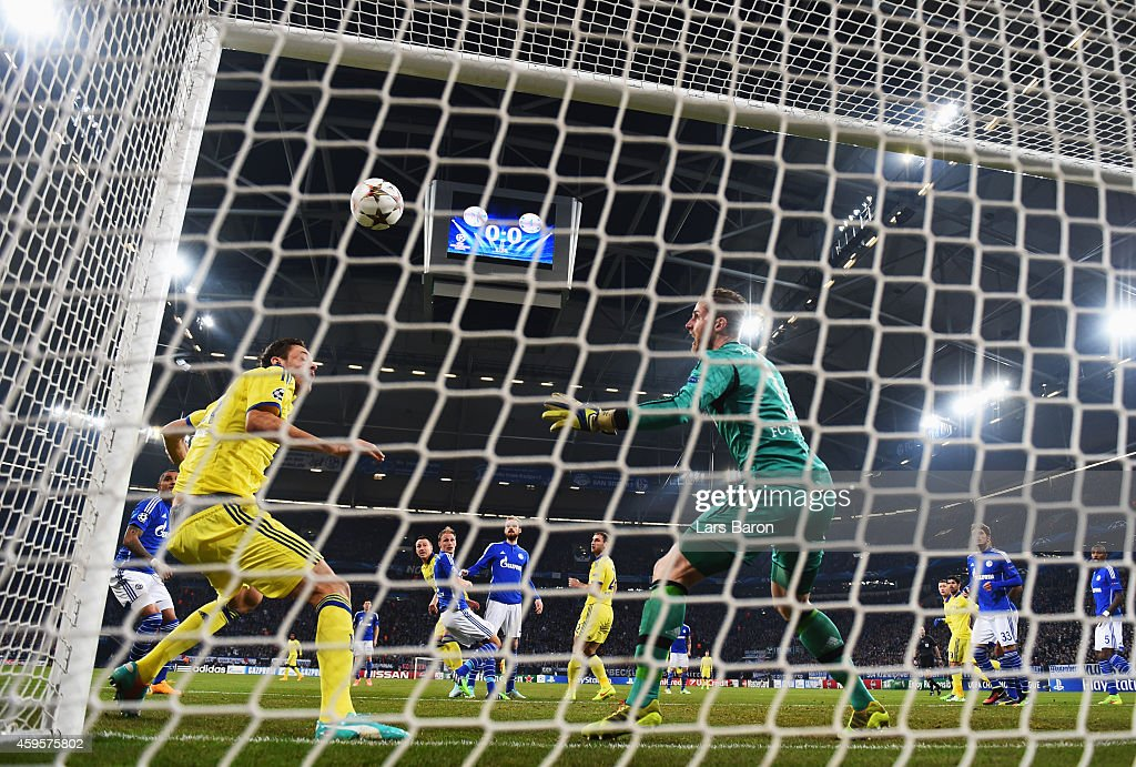 Goalkeeper Ralf Faehrmann of Schalke and Nemanja Matic of Chelsea look on as John Terry of Chelsea (3L) scores their first goal during the UEFA Champions League Group G match between FC Schalke 04 and Chelsea FC at Veltins-Arena on November 25, 2014 in Gelsenkirchen, Germany.