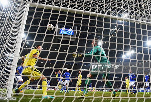Goalkeeper Ralf Faehrmann of Schalke and Nemanja Matic of Chelsea look on as John Terry of Chelsea scores their first goal during the UEFA Champions...