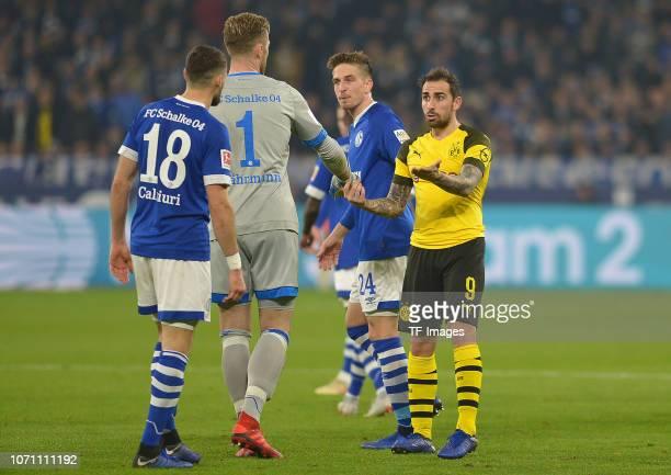Goalkeeper Ralf Faehrmann of Schalke and Paco Alcacer of Dortmund gestures during the Bundesliga match between FC Schalke 04 and Borussia Dortmund at...