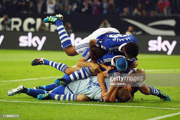 Goalkeeper Ralf Faehrmann of Schalke celebrates with team mates after winning the Supercup match against Borussia Dortmund at Veltins Arena on July...
