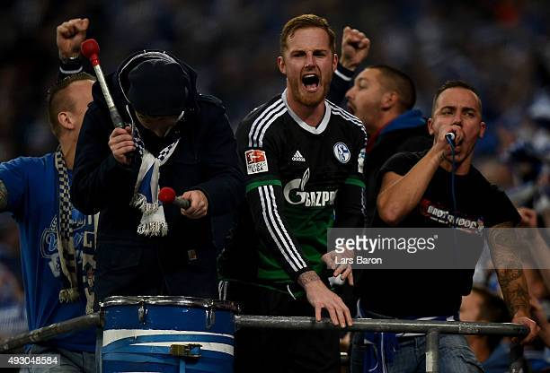 Goalkeeper Ralf Faehrmann of Schalke celebrates with the fans after winning the Bundesliga match between FC Schalke 04 and Hertha BSC Berlin at...