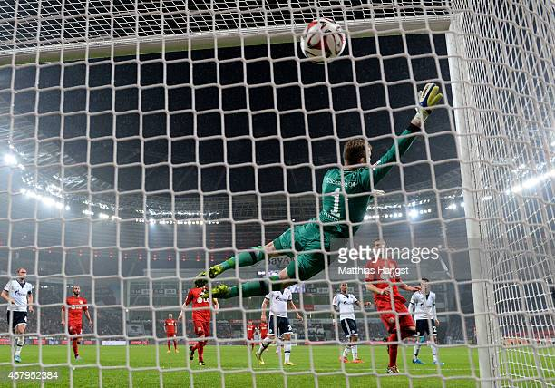 Goalkeeper Ralf Faehrmann of Schalke dives in vain as Hakan Calhanoglu of Bayer Leverkusen scores the only goal of the gameduring the Bundesliga...