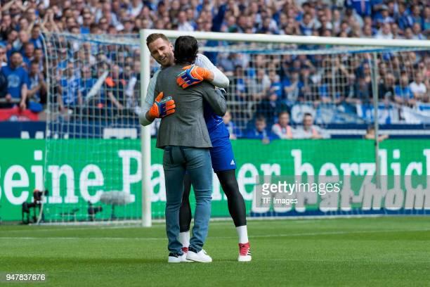 Goalkeeper Ralf Faehrmann of Schalke hugs Raul prior to the Bundesliga match between FC Schalke 04 and Borussia Dortmund at VeltinsArena on April 15...