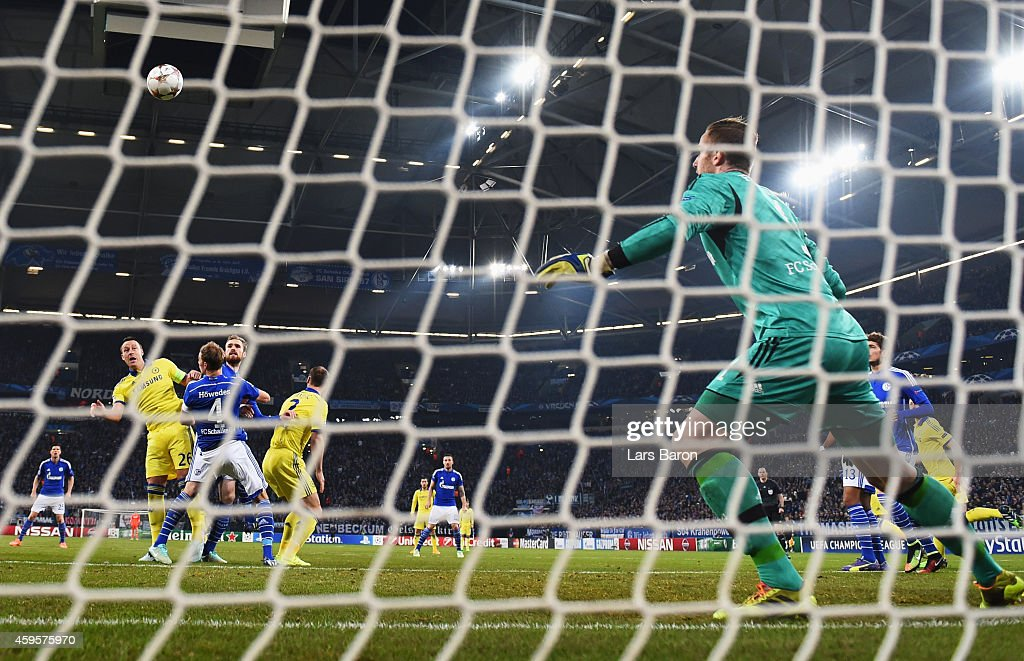 Goalkeeper Ralf Faehrmann of Schalke looks on as John Terry of Chelsea (2L) scores their first goal during the UEFA Champions League Group G match between FC Schalke 04 and Chelsea FC at Veltins-Arena on November 25, 2014 in Gelsenkirchen, Germany.