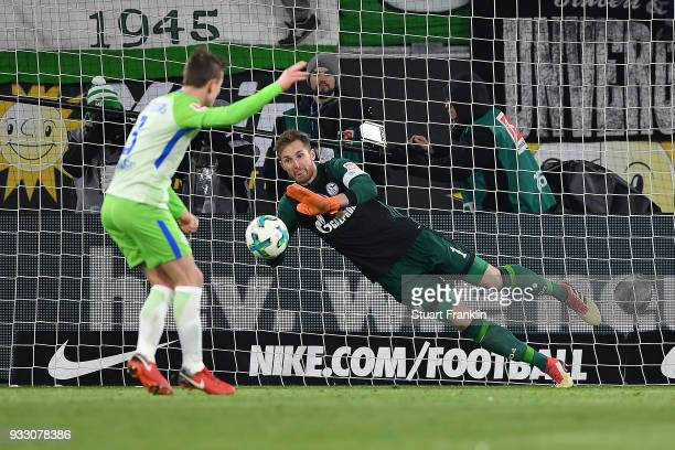 Goalkeeper Ralf Faehrmann of Schalke saves a penalty against Paul Verhaegh of Wolfsburg during the Bundesliga match between VfL Wolfsburg and FC...