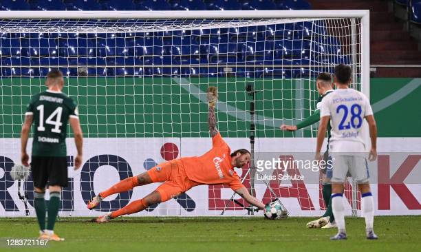 Goalkeeper Ralf Faehrmann of Schalke saves penalty from Amar Suljic of Schweinfurt during the DFB Cup first round match between 1. FC Schweinfurt 05...