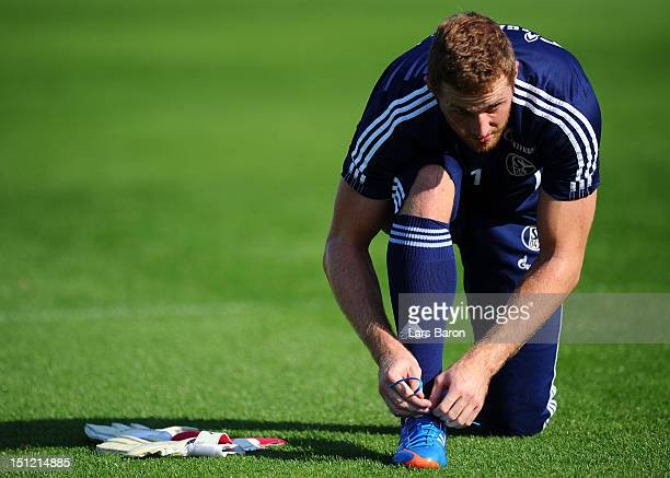 Goalkeeper Ralf Faehrmann prepares prior to a FC Schalke 04 training session on September 4 2012 in Gelsenkirchen Germany