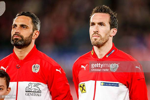 Goalkeeper Ramazan Oezcan and Christian Fuchs of Austria line up during the national anthem prior to the international friendly match between Austria...