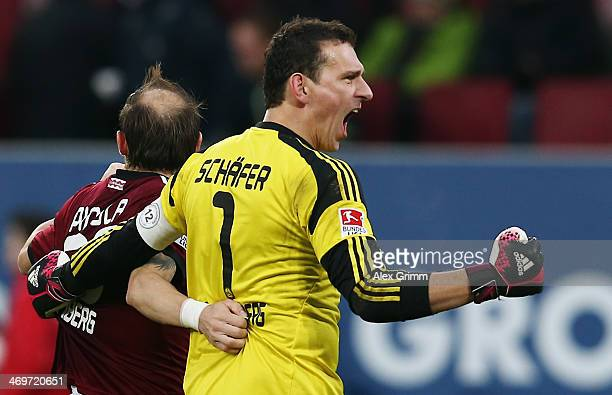 Goalkeeper Raphael Schaefer and Javier Pinola of Nuernberg celebrate after the Bundesliga match between FC Augsburg and 1 FC Nuernberg at SGL Arena...