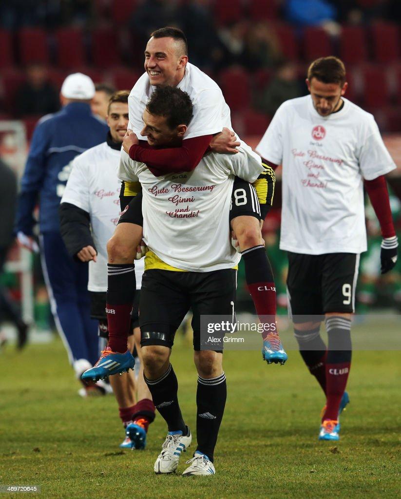 Goalkeeper Raphael Schaefer and Josip Drmic of Nuernberg celebrate after the Bundesliga match between FC Augsburg and 1. FC Nuernberg at SGL Arena on February 16, 2014 in Augsburg, Germany.