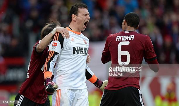 Goalkeeper Raphael Schaefer of Nuernberg cheers after parrying Braunschweigs second penalty during the Bundesliga match between 1 FC Nuernberg and...