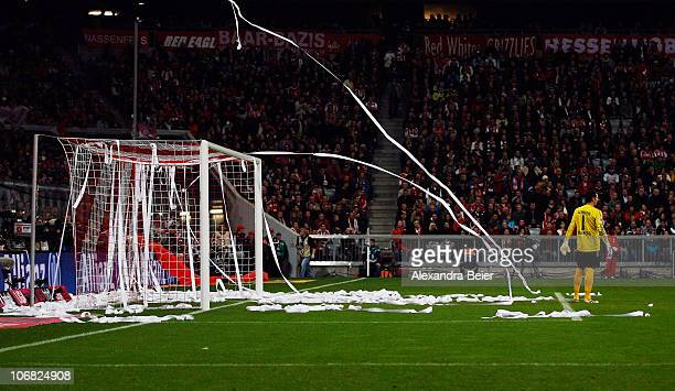 Goalkeeper Raphael Schaefer of Nuernberg reacts as Bayern Muenchen fans throw toilet paper onto the pitch during the Bundesliga match between FC...