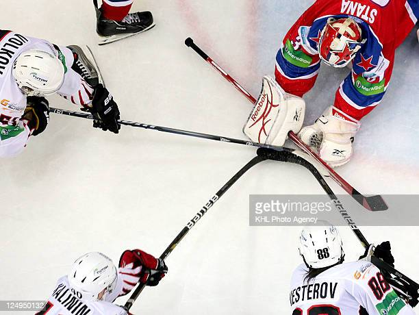 Goalkeeper Rastislav Stana of CSKA Moscow stops the puck during the game against Avangard Omsk during the KHL Championship 2011/2012 on September 14...