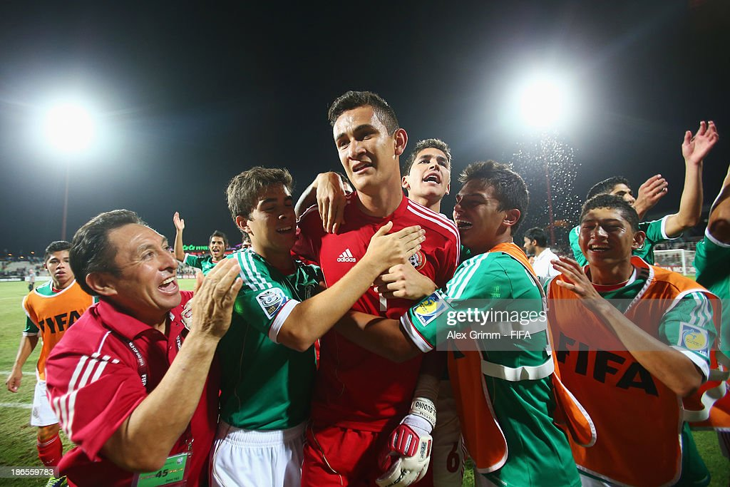 Goalkeeper Raul Gudino of Mexico celebrates with team mates after winning the penalty shootout during the FIFA U-17 World Cup UAE 2013 Quarter Final match between Brazil and Mexico at Al Rashid Stadium on November 1, 2013 in Dubai, United Arab Emirates.