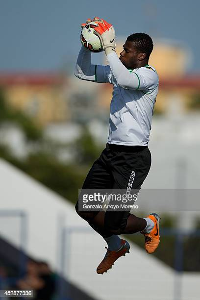 Goalkeeper Razak Brimah of Cordoba CF stops the ball during his warming up prior to start the friendly football match between Marbella FC and Cordoba...