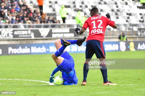 Goalkeeper Regis Gurtner of Amiens just manages to stop himself handling the ball outside the penalty area during the Ligue 1 match between Amiens SC...