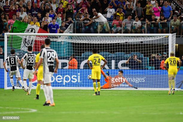 Goalkeeper Remy Descamps of PSG is beaten as a late penalty by Claudio Marchisio of Juventus wins the team for his side during the International...