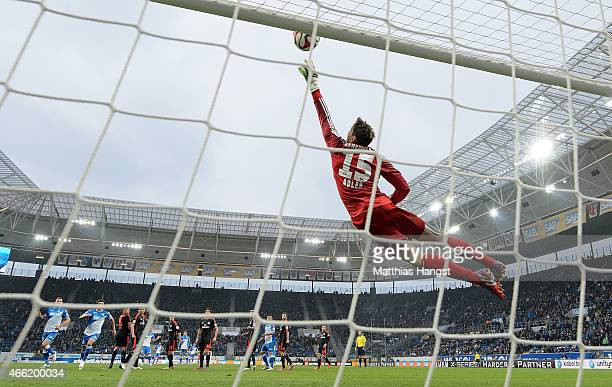 Goalkeeper Rene Adler of Hamburg saves a ball during the Bundesliga match between 1899 Hoffenheim and Hamburger SV at Wirsol RheinNeckarArena on...