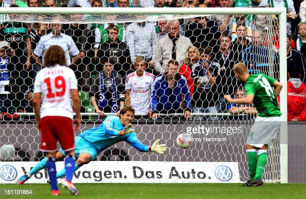 Goalkeeper Rene Adler of Hamburg saves a penalty from Aaron Hunt of Bremen during the Bundesliga match between Werder Bremen and Hamburger SV at...