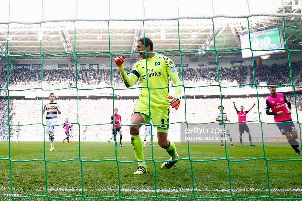 Goalkeeper, Rene Adler of Hamburger SV celebrates after he saves the penalty from Andre Hahn of Borussia Moenchengladbach during the Bundesliga match between Borussia Moenchengladbach and Hamburger SV at Borussia-Park on October 15, 2016 in Moenchengladbach, Germany.