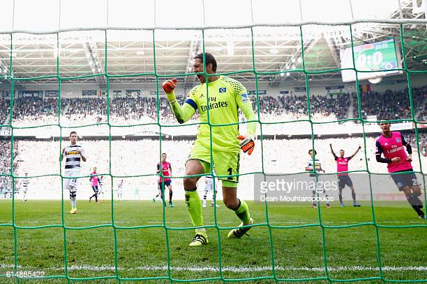 Goalkeeper Rene Adler of Hamburger SV celebrates after he saves the penalty from Andre Hahn of Borussia Moenchengladbach during the Bundesliga match...