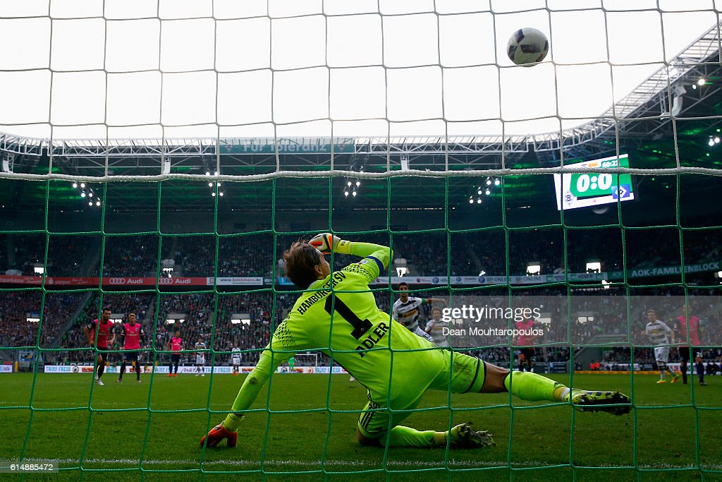 Goalkeeper, Rene Adler of Hamburger SV watches the penalty from Lars Stindl of Borussia Moenchengladbach hit the crossbar and not go in during the Bundesliga match between Borussia Moenchengladbach and Hamburger SV at Borussia-Park on October 15, 2016 in Moenchengladbach, Germany.