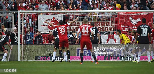 Goalkeeper Rene Adler of Leverkusen misses to save Bayern Muenchen's first goal during the Bundesliga match between FC Bayern Muenchen and Bayer...