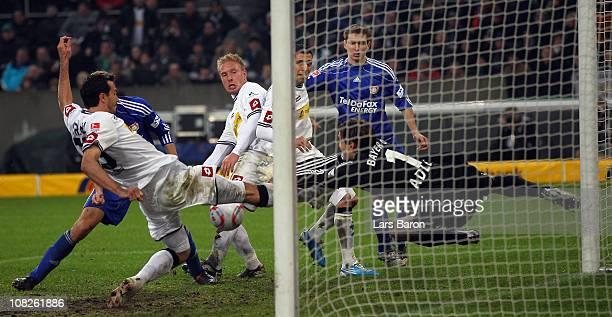 Goalkeeper Rene Adler of Leverkusen pushes the ball before MArtin Stranzl and Mike Hanke of Moenchengladbach during the Bundesliga match between...