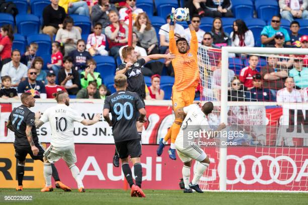 Goalkeeper Richard Sanchez of Chicago Fire takes a high cross while challenged by Tim Parker of New York Red Bulls during the New York Red Bulls Vs...