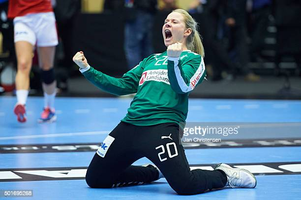 Goalkeeper Rikke Poulsen of Denmark celebrate after penalty save at last second in ordinary time during the 22nd IHF Women's Handball World...