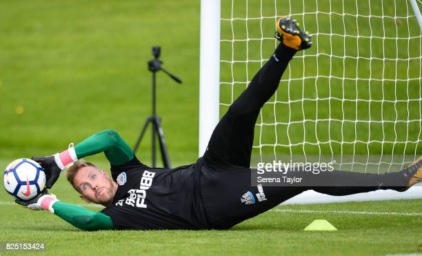 Goalkeeper Rob Elliot catches the ball during the Newcastle United Training session at the Newcastle United Training ground on August 1 in Newcastle...