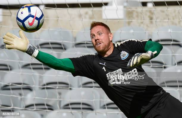 Goalkeeper Rob Elliot dives for the ball during a Newcastle United Open Training session at StJames' Park on August 17 in Newcastle upon Tyne England