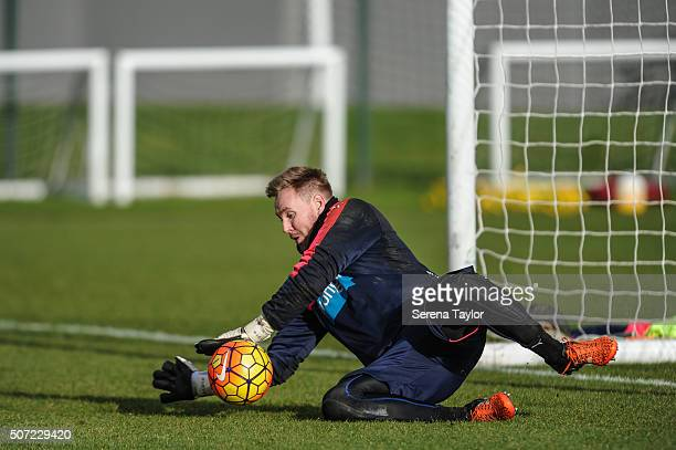 Goalkeeper Rob Elliot dives on the grass to catch the ball during the Newcastle United Training session at The Newcastle United Training Centre on...
