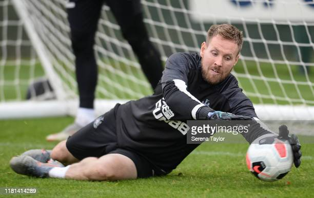 Goalkeeper Rob Elliot dives to make a save during the Newcastle United Training Session at the Newcastle United Training Centre on October 16 2019 in...