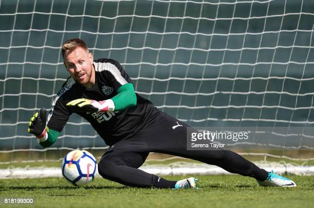 Goalkeeper Rob Elliot dives to make a save during the Newcastle United Training session at Carton House on July 18 in Maynooth Ireland