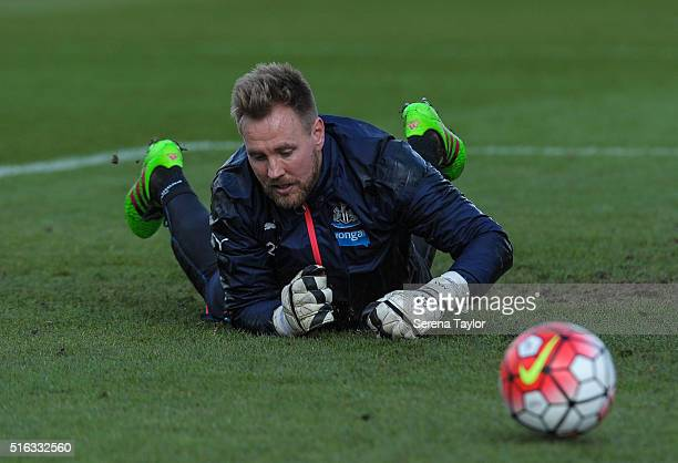 Goalkeeper Rob Elliot lays on the ground as the ball passes during the Newcastle United Training session at The Newcastle United Training Centre on...