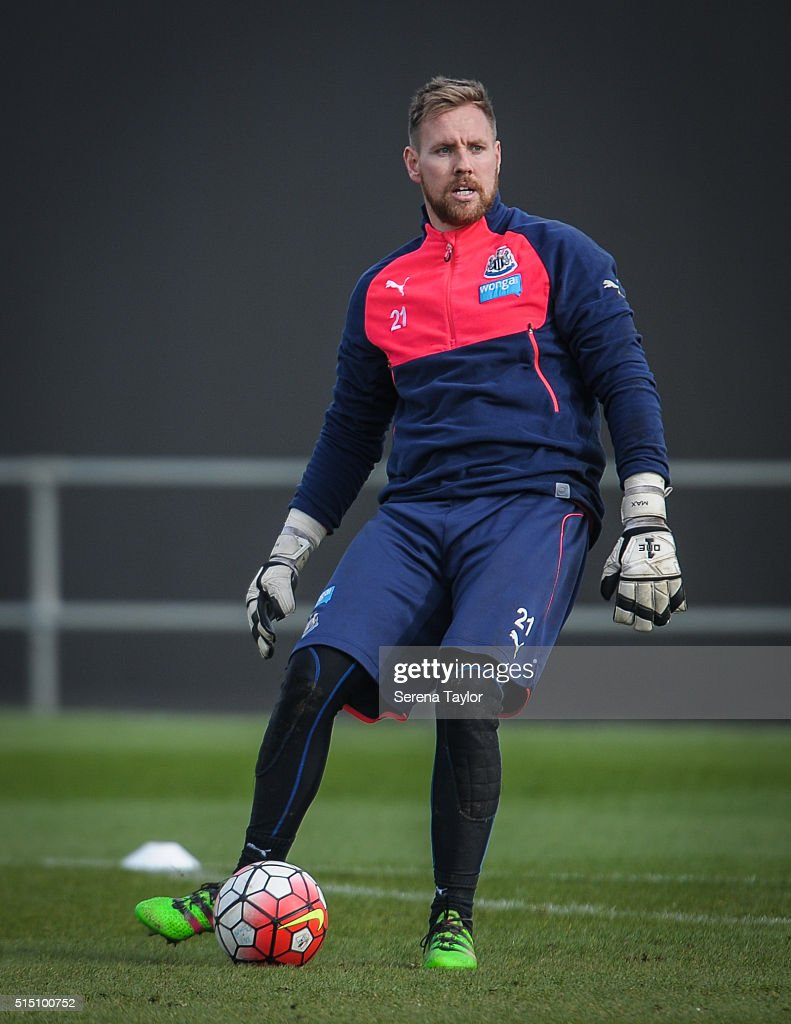 Goalkeeper Rob Elliot looks to pass the ball during the Newcastle United training session at The Newcastle United Training Centre on March 12, 2016, in Newcastle upon Tyne, England.
