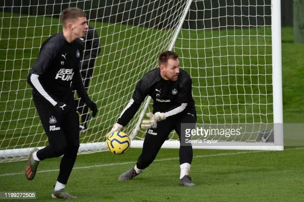 Goalkeeper Rob Elliot looks to pass the ball into play during the Newcastle United Training Session at the Newcastle United Training Centre on...