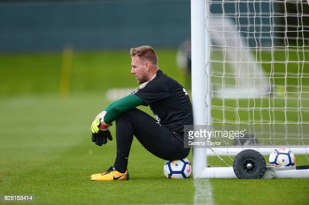 Goalkeeper Rob Elliot sits on a ball against the goal during the Newcastle United Training session at the Newcastle United Training ground on August...
