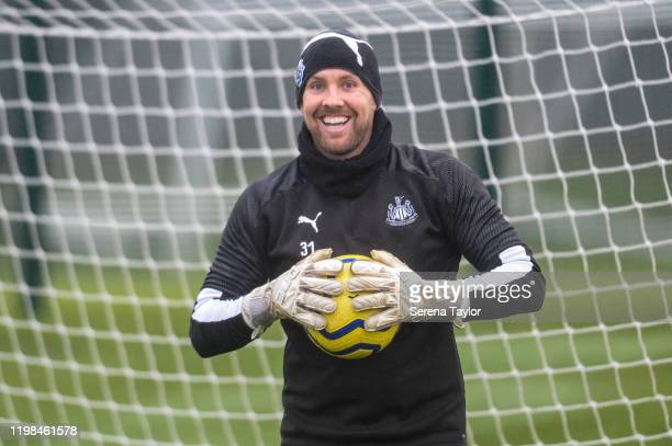 Goalkeeper Rob Elliot smiles as he holds the ball during the Newcastle United Training Session at the Newcastle United Training Centre on January 09...