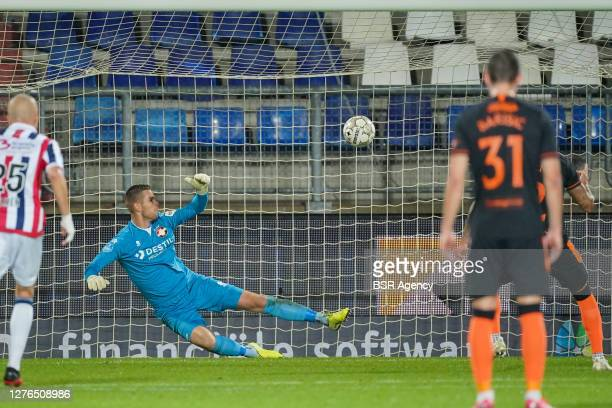 Goalkeeper Robbin Ruiter of Willem II concedes a goal from the penalty spot scored by James Tavernier of Rangers during the UEFA Europa League third...