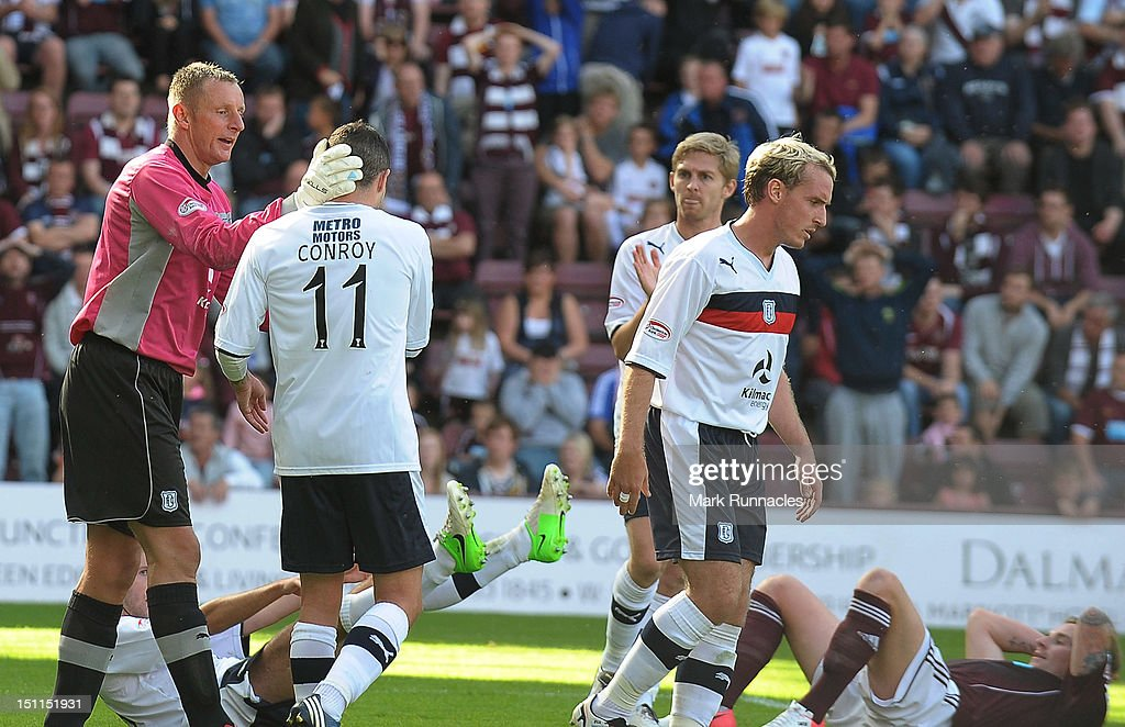 Goalkeeper Robert Douglas of Dundee congratulates Ryan Conroy for making a clearance from the goal line during the Clydesdale Bank Scottish Premier League match between Hearts and Dundee at Tyncastle Stadium on September 2, 2012 in Edinburgh, Scotland.