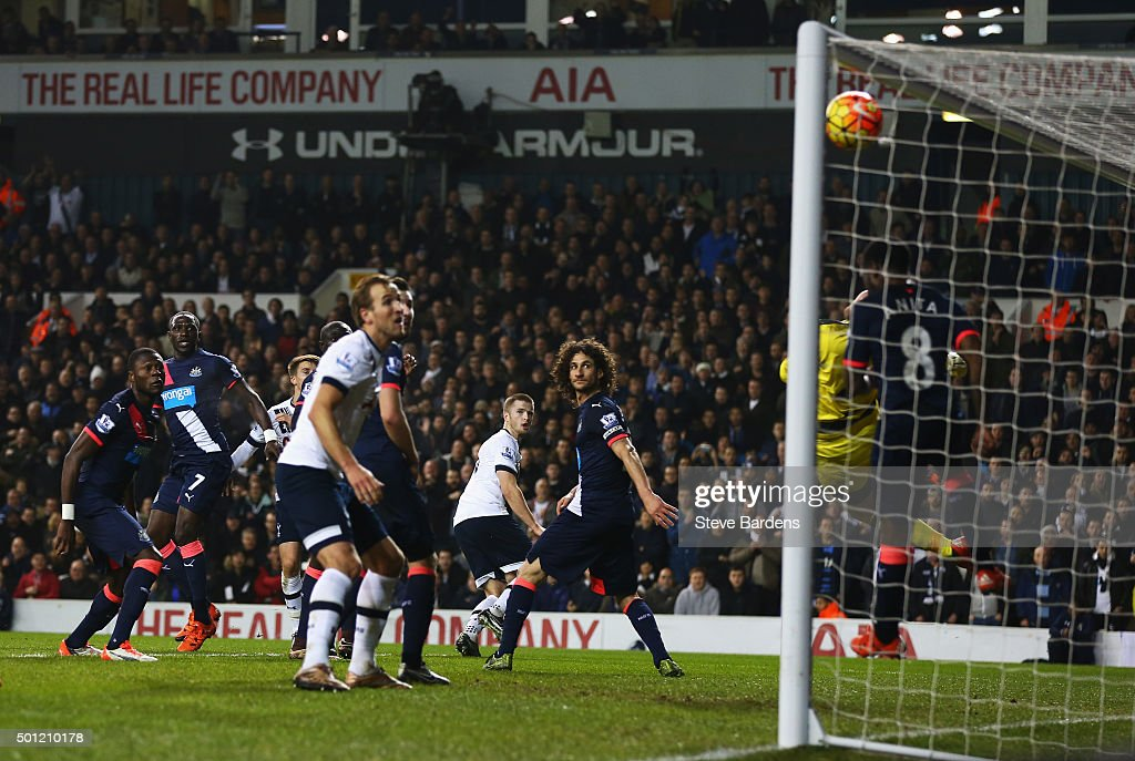 Goalkeeper Robert Elliot of Newcastle United and Vurnon Anita of Newcastle United (8) fail to stop Eric Dier of Tottenham Hotspur (C) from scoring their first goal during the Barclays Premier League match between Tottenham Hotspur and Newcastle United at White Hart Lane on December 13, 2015 in London, England.