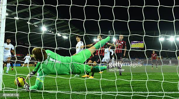 QPR goalkeeper Robert Green makes a finger tip save from Gylfi Sigurdsson during the Barclays Premier League match between Swansea City and Queens...