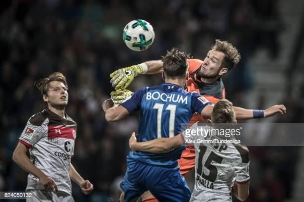 Goalkeeper Robin Himmelmann of St Pauli clears the ball ahead of Dimitrios Diamantakos of Bochum during the Second Bundesliga match between VfL...
