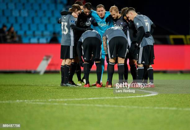 Goalkeeper Robin Olsen of FC Copenhagen and his team mates huddle prior to the second half during the Danish Alka Superliga match between AaB Aalborg...