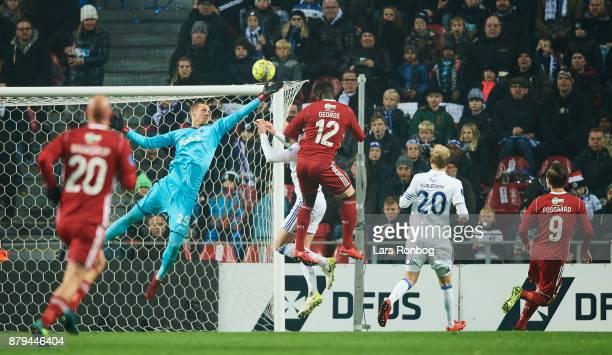 Goalkeeper Robin Olsen of FC Copenhagen in action against Mayron George of Lyngby BK during the Danish Alka Superliga match between FC Copenhagen and...