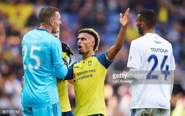 Goalkeeper Robin Olsen of FC Copenhagen in discussion with Hany Mukhtar of Brondby IF during the Danish Alka Superliga match between Brondby IF and...