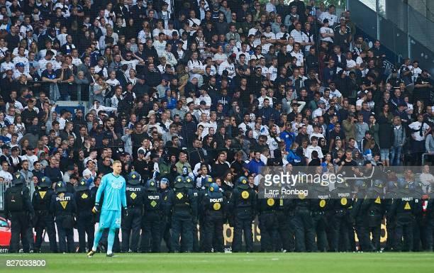 Goalkeeper Robin Olsen of FC Copenhagen in front the the police guarding the FC Copenhagen fans during the Danish Alka Superliga match between...
